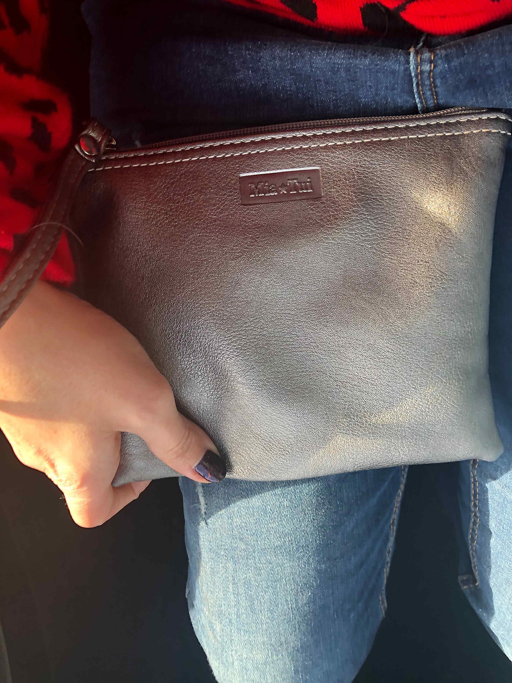Metallic grey Mia Tui Samantha clutch bag with wrist strap