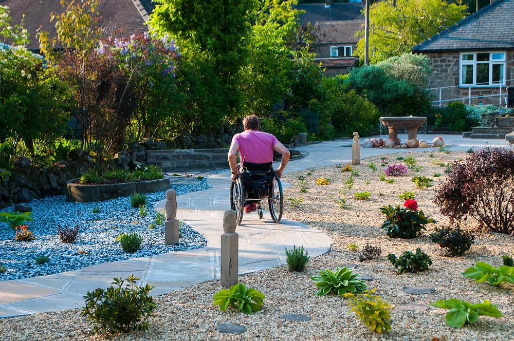 Wheelchair user in Croft Bungalow garden
