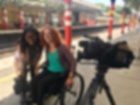 Carrie-Ann and a news reporter next to filming equipment