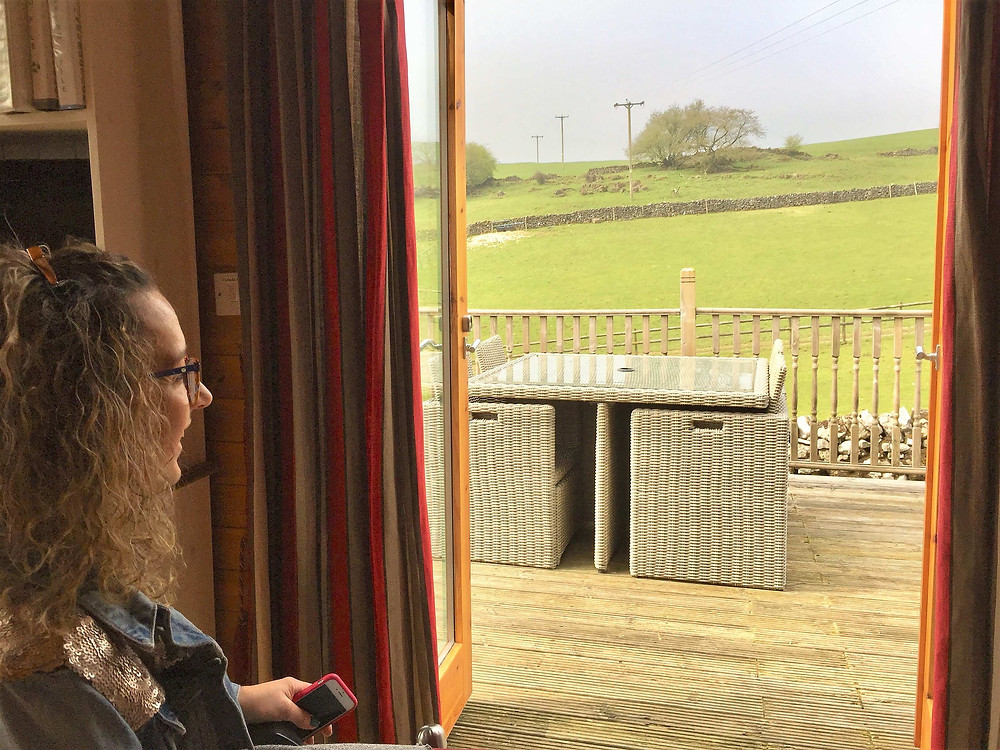 Carrie-Ann Lightley Disabled Travel Blogger looking at the farm fields out of the window