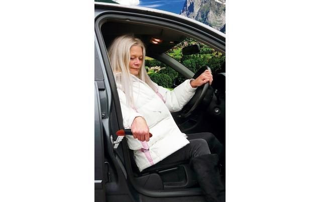 Woman using car support handle