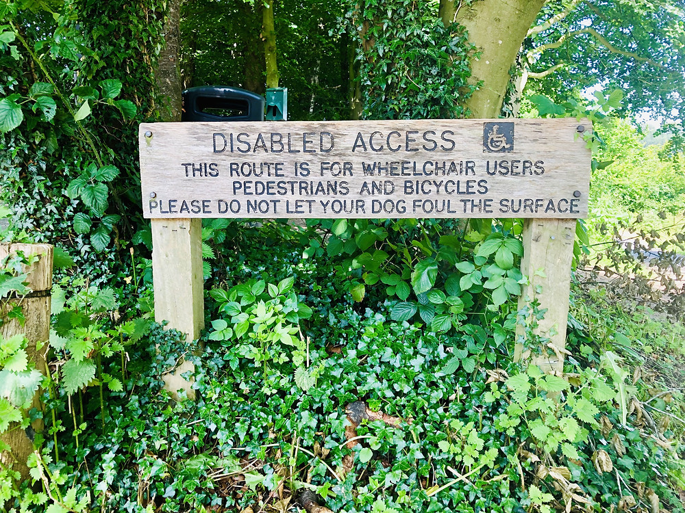 Wooden sign on path reads - Disabled Access, this route is for wheelchair users
