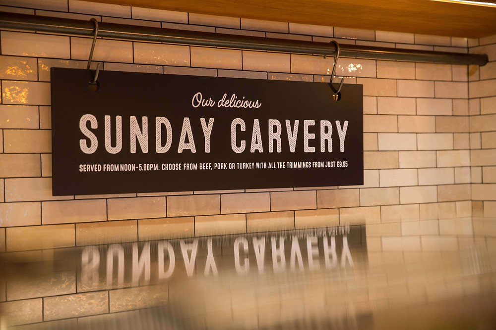 Sign reads 'Our delicious Sunday carvery'
