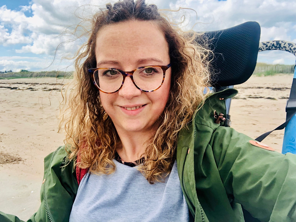 Carrie-Ann using a beach wheelchair on St Andrews Beach