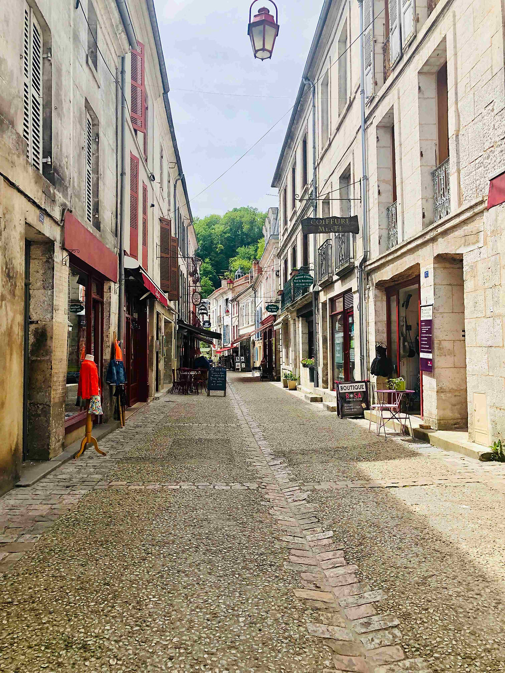 Cobbled shopping street in Brantome, France