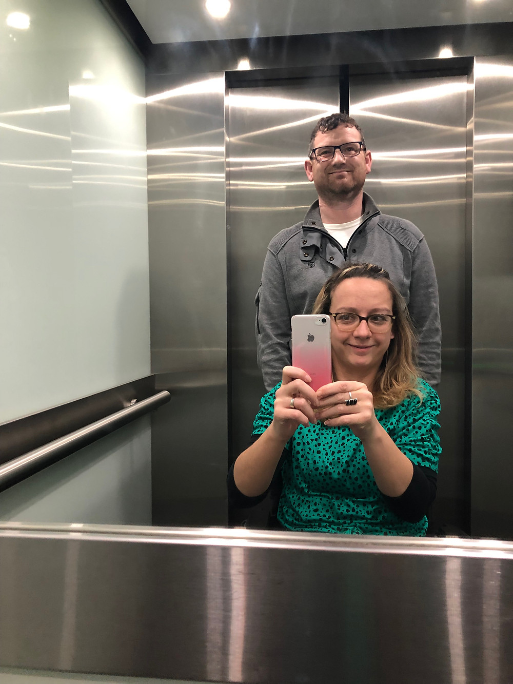 A man and a woman in a lift