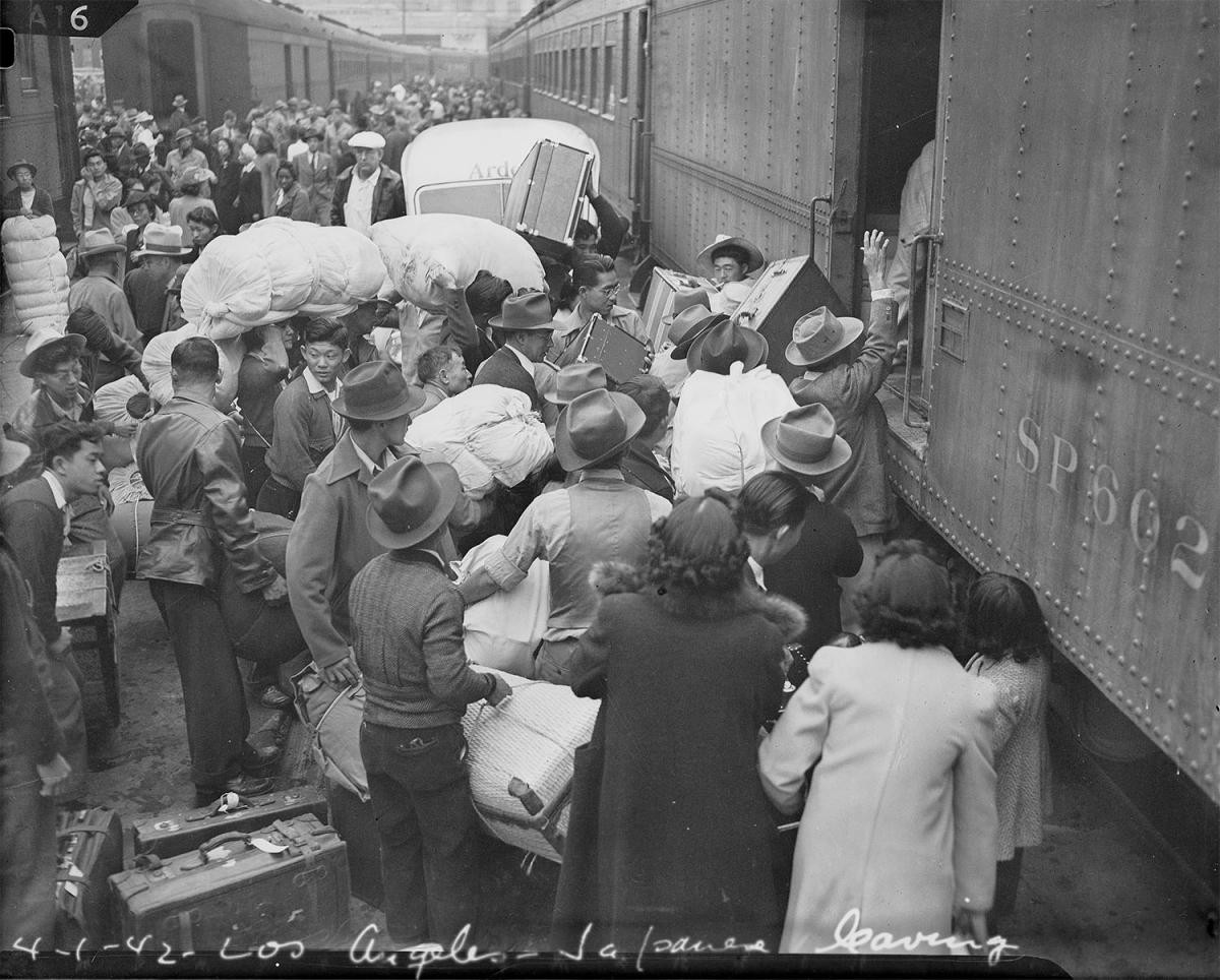 Japanese Americans Board Trains