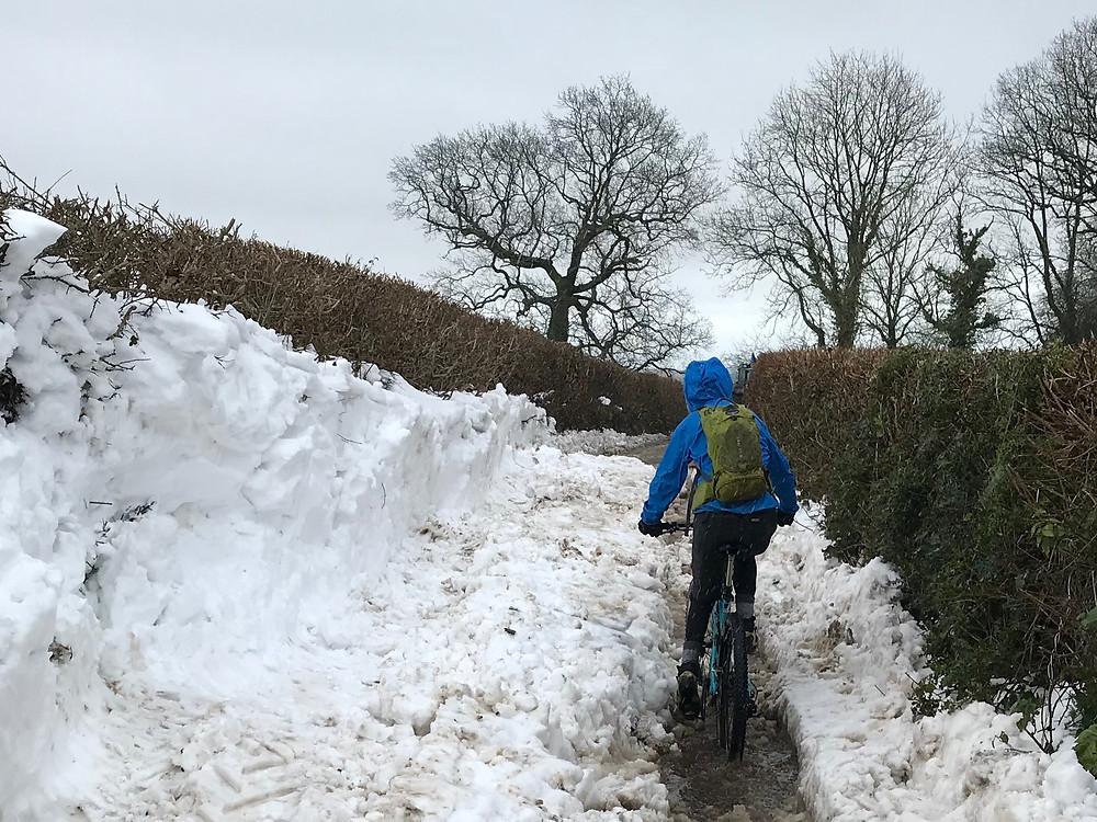 Mountain bike in snowy lane