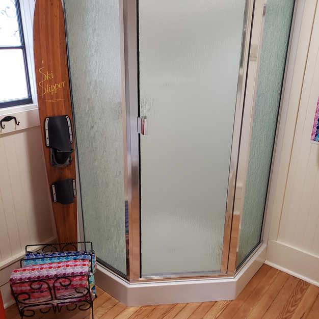 Shower with original fir flooring