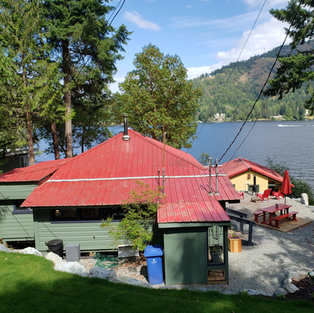 View of Tailor's Cabin & Birdhouse from parking area