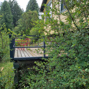 Very private deck with bistro set and loveseat rocker