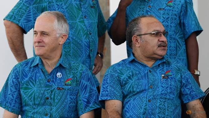 Australian PM Turnbull & PNG PM O'Neill at the 2017 Pacific Islands Forum. Same shirt, different directions. Image AAP/Lukas Coch/via REUTERS