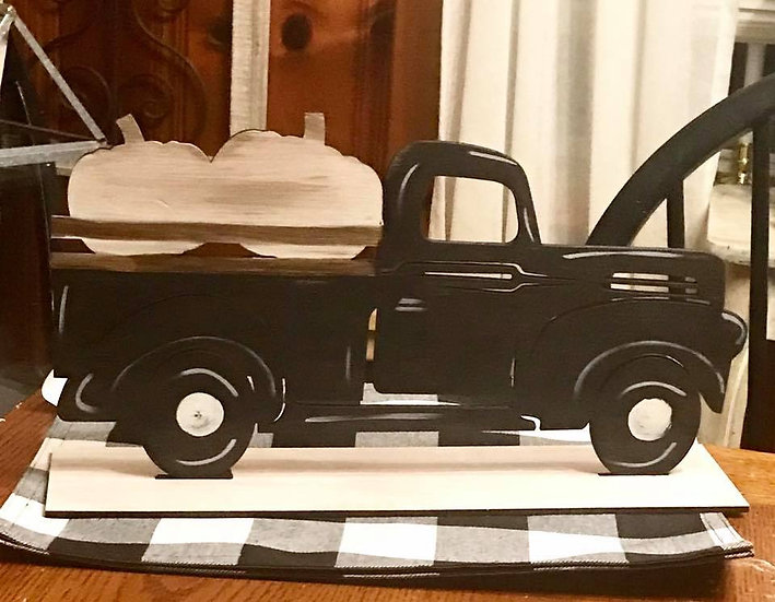 vintage stand up truck with pumpkins