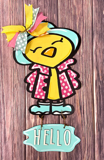 Door hanger with a chick wearing a raincoat, rain boots, and a hat with a bow on it