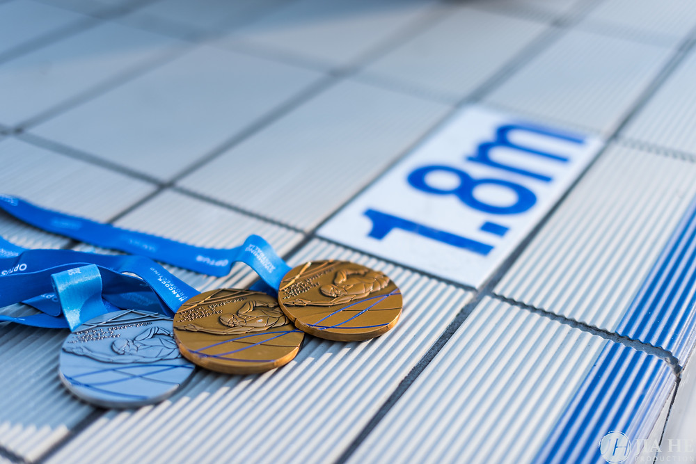 The winner medals in swimming