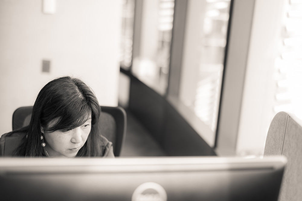 A woman is watching computer