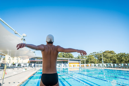 A swimmer is warming up