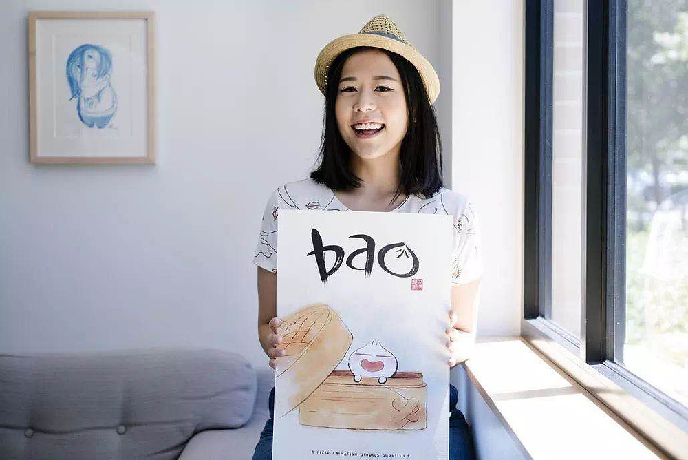 Domee Shi, the animation director, held the poster of her Oscar awarded work, Bao