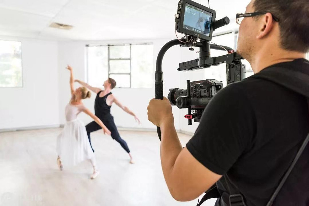 A camera man is shooting a ballet performance
