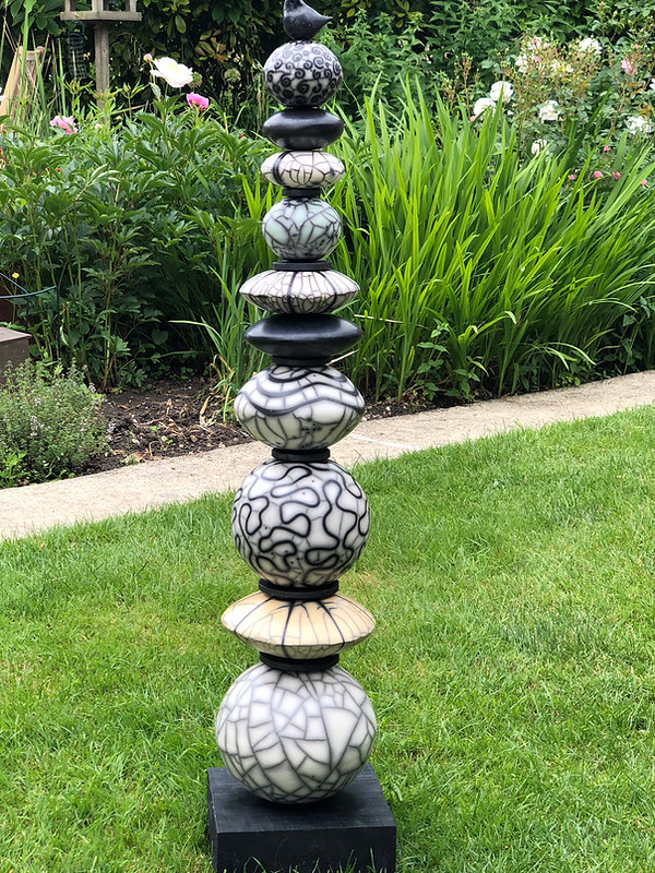 Naked raku totem - demonstrating a variety of decorative techniques