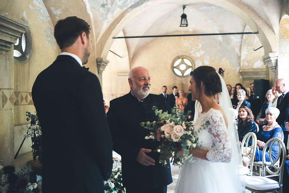 Wedding at the Vajdahunyad Castle in Budapest - father gives her daughter away
