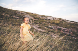 4 year old in among tall grass