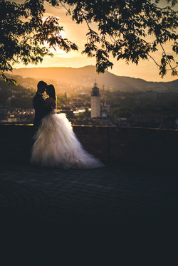 wedding photo at sunset with a church in the background