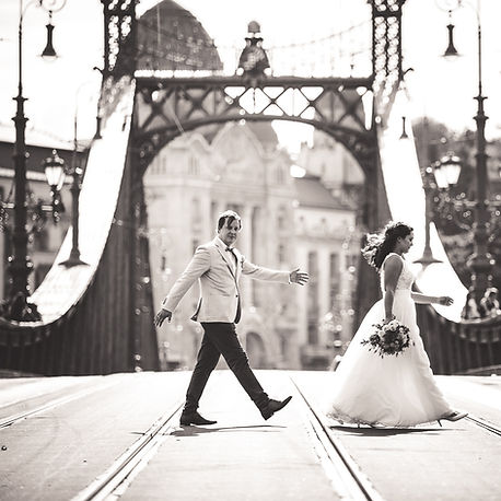 newly weds are crossing Liberty Bridge in Budapest over the Danube rive