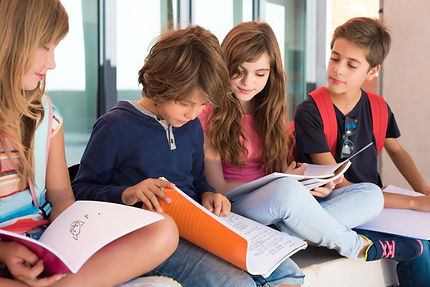 students looking at homework