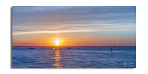 Arcachon, Les voiliers au levé du soleil.