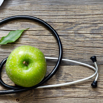 stethoscope on table with apple (1).jpg