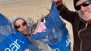 Take a walk along the beach with a couple of Beach Cleanup Superhero's