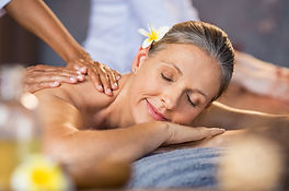 Woman lying on a spa bed and getting a r