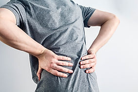 Close up hands touching back pain.jpg