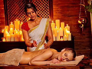 Young woman having oil Ayurveda spa with