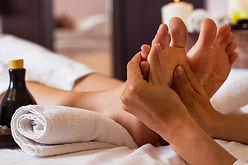 Massage of human foot in spa salon - Sof