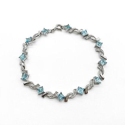 9ct White Gold Bracelet set with Blue Topaz and Diamonds