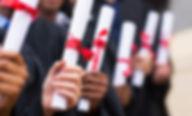 group of multiracial graduates holding d
