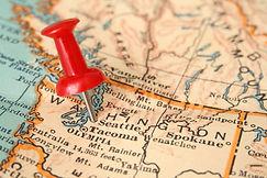 A push pin on a map marking Seattl, WA