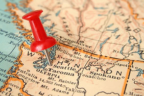 A map of the Pacific Northwest of the USA with a push pin marking Seattle, WA