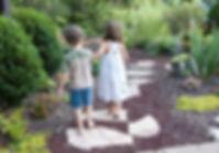 Children walkig down a stone path together