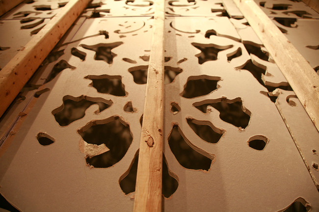 Heirloom, hand carved drywall and dust