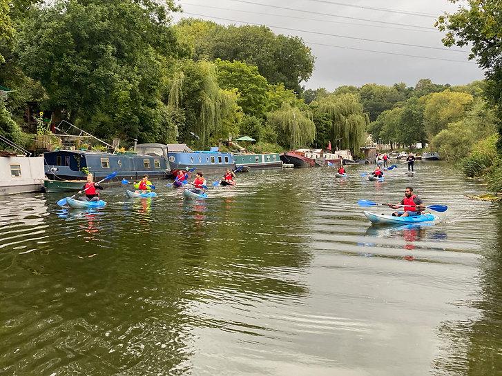 Group Kayaking and Paddleboarding along the river