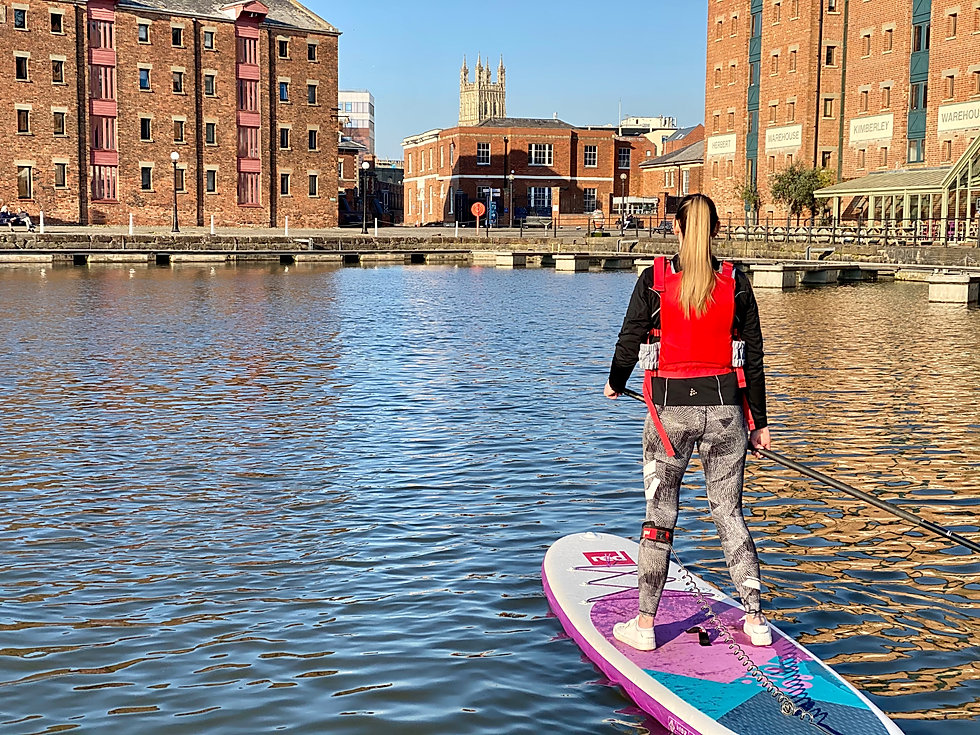 Lady Paddleboarding SUP Gloucester Cathedral