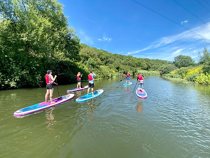Group Paddleboarding along the river