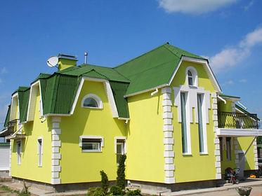 дом покрашенный фасадной краской спелой дыней