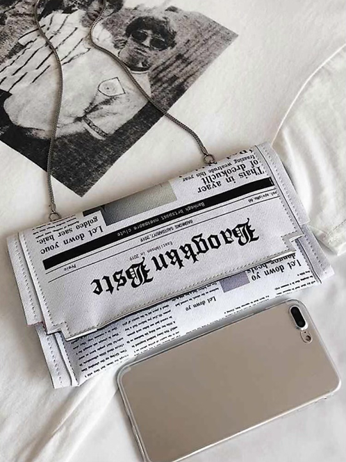 NEWSPAPER CLUTCH