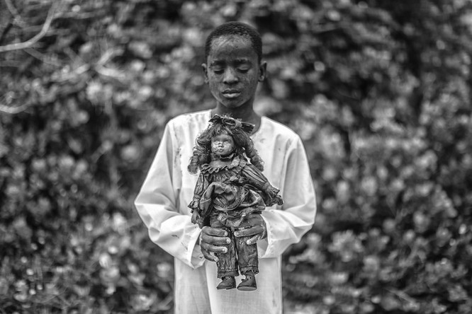 A boy with a toy, 2018