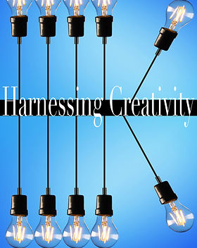 "Lightbulbs hanging and standing from a black strip with title ""Harnessing Creativity"""
