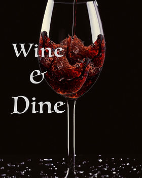 "A wine glass being filled on a black backdrop and shattered glass at the bottom of the image. Cover title, ""Wine & Dine"" is on this poetry cover."